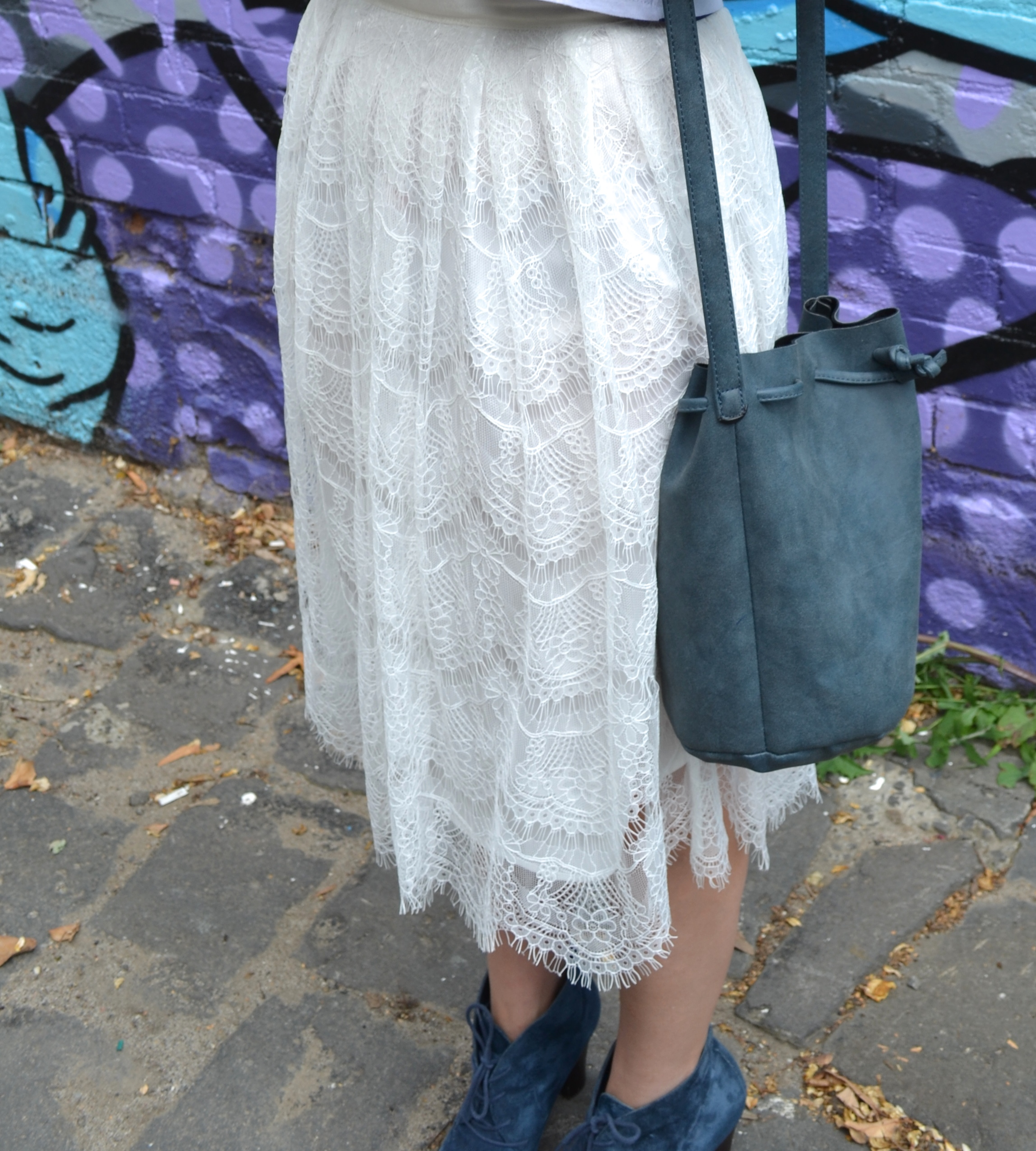 lace-midi-skirt-dark-blue-bucket-bag