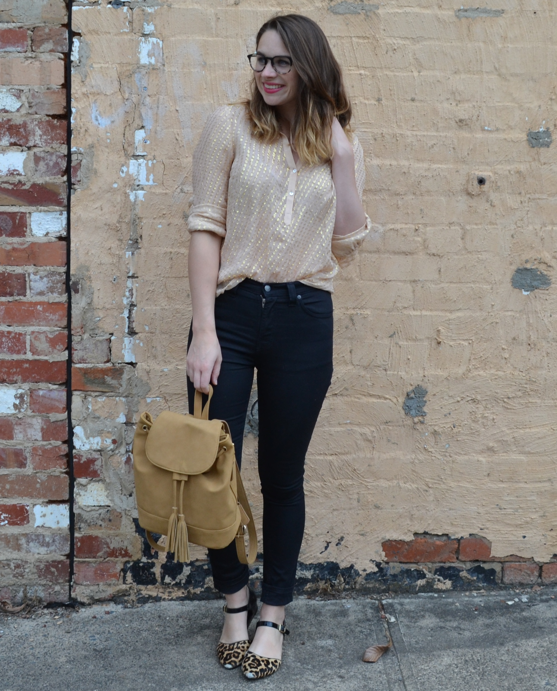 tan-backpack-gold-zara-top-black-nudie-jeans