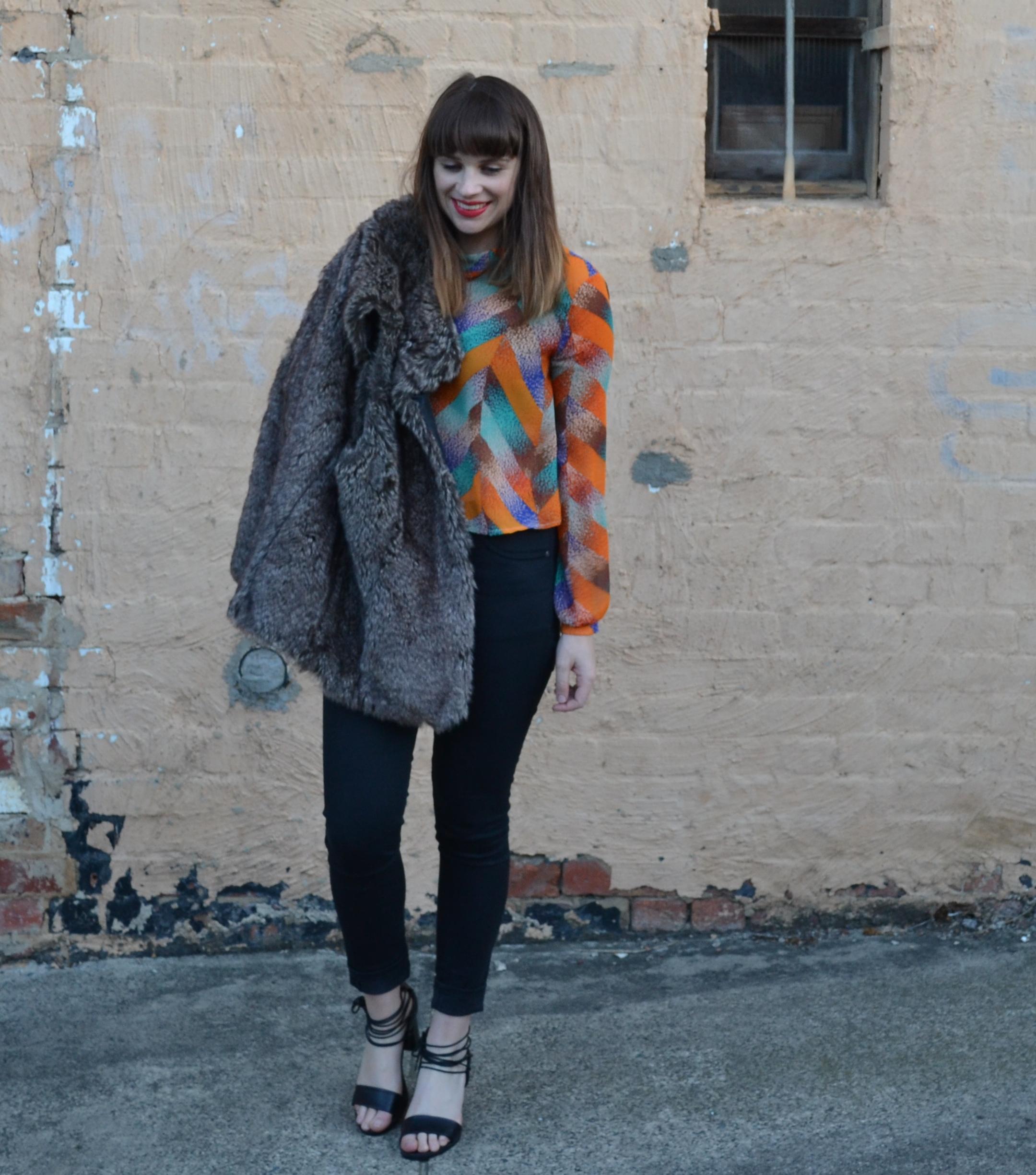 fur-vest-black-jeans-girl-bangs