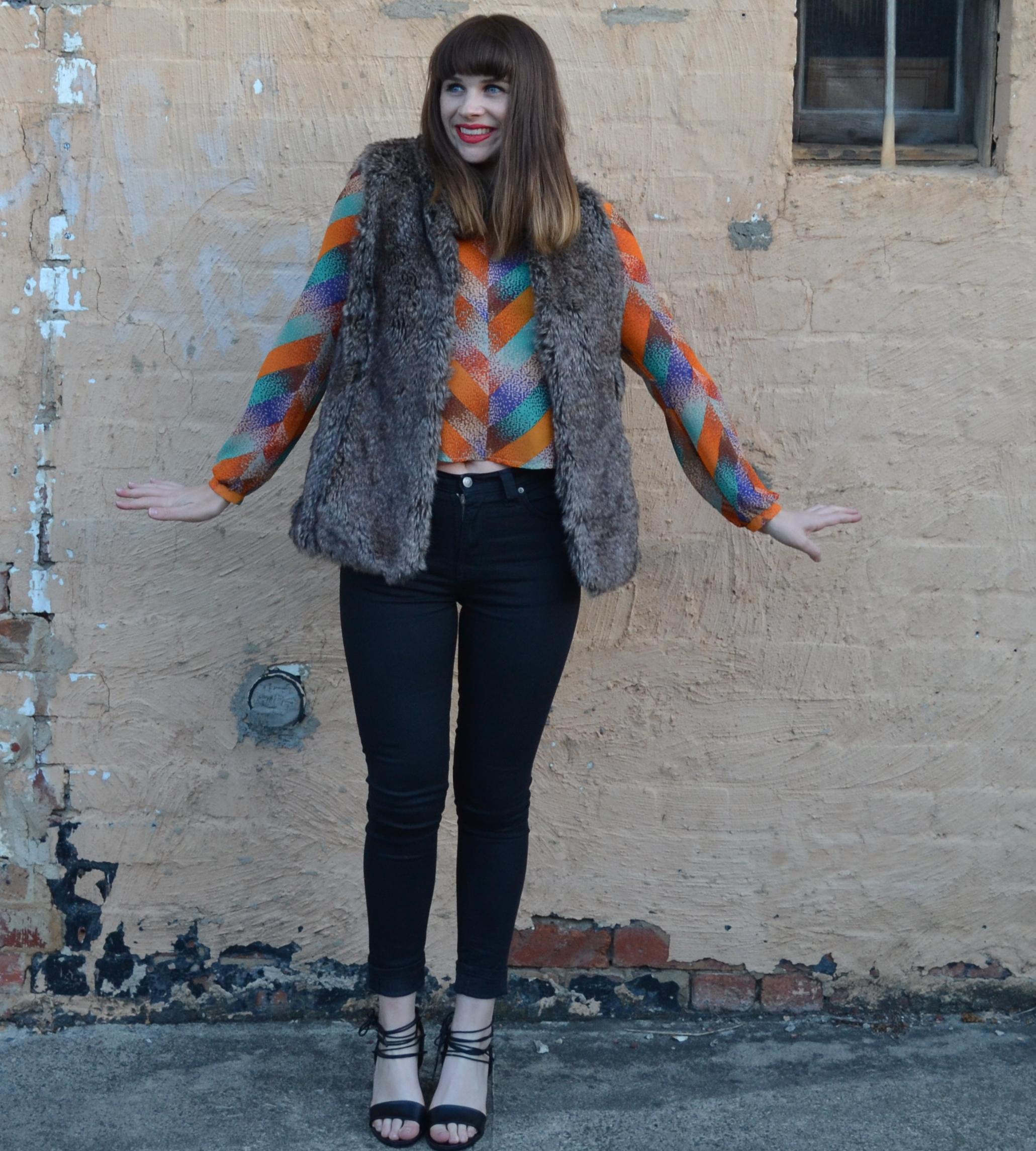 fur-vest-bright-blouse-girl-brunette-bangs