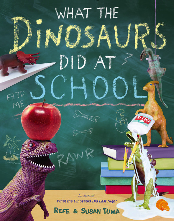 """What the Dinosaurs Did At School - IN STORES NOW!In the follow-up to the hit What the Dinosaurs Did Last Night, everyone's favorite plastic dinosaurs make the trip to school. Each scene is photographed in meticulous detail, letting viewers joyfully suspend disbelief and think to themselves--just LOOK at what these diminutive dinos did at school!Perfect for kids of all ages—and their parents.""""The Tumas' neon photographs of toy dinos draped in spaghetti, bouncing on soccer balls and devouring library books are mini-masterpieces of creativity.""""— USA Today"""
