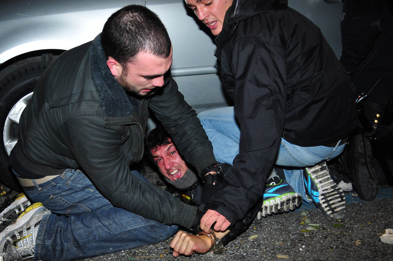 A man is arrested during violent anti-austerity clashes in Madrid, Spain.