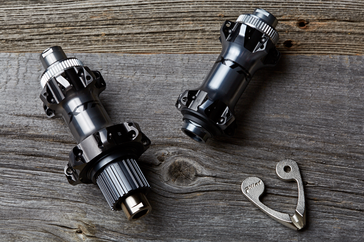 Shimano's XTR Micro Spline 12 speed hubs in a straight pull spoke configuration with centrelock disc brakes.