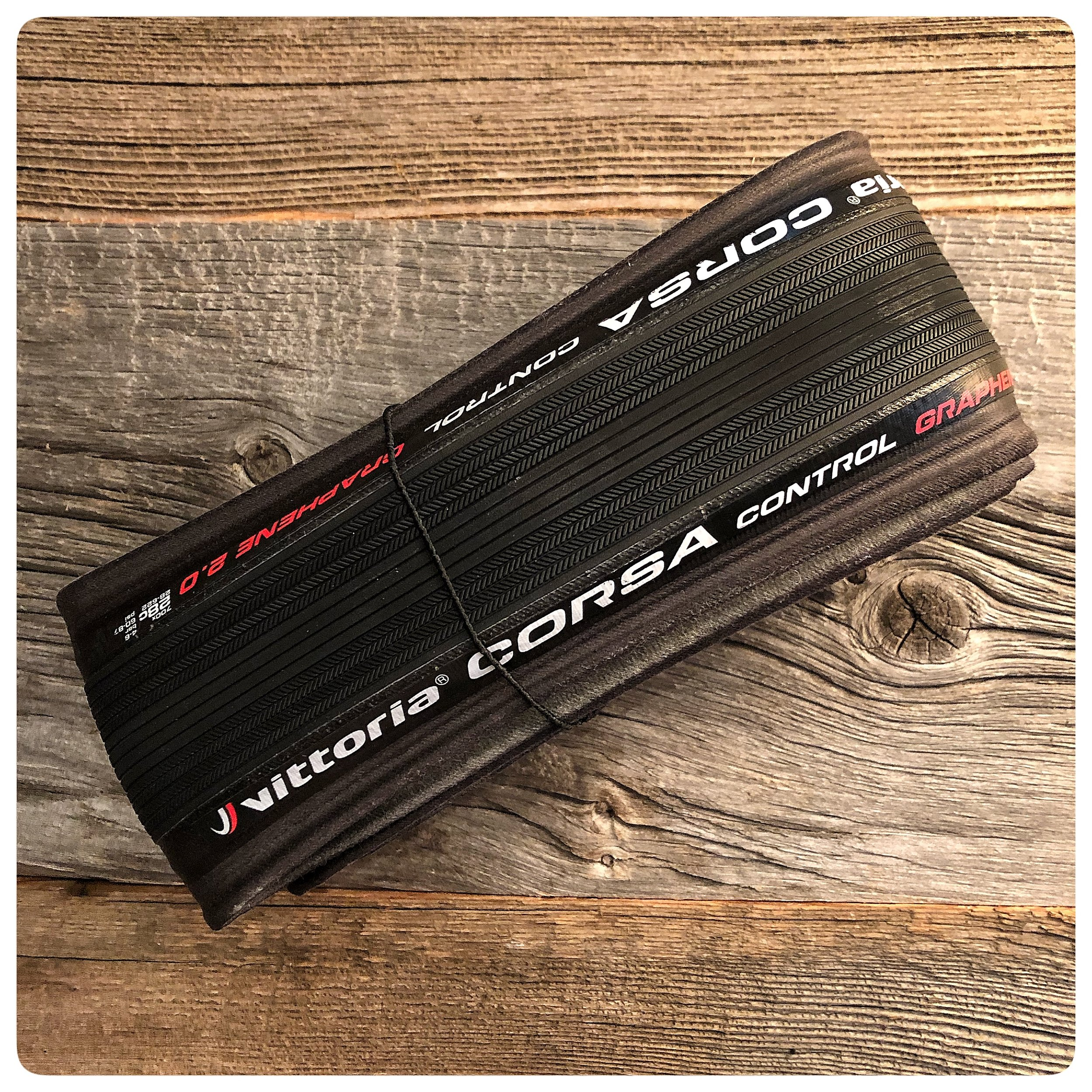 Vittoria's Corsa Control tire. Graphene infused with a 320 TPI cotton casing. Super low rolling resistance and excellent grip. Fast, fast fast!
