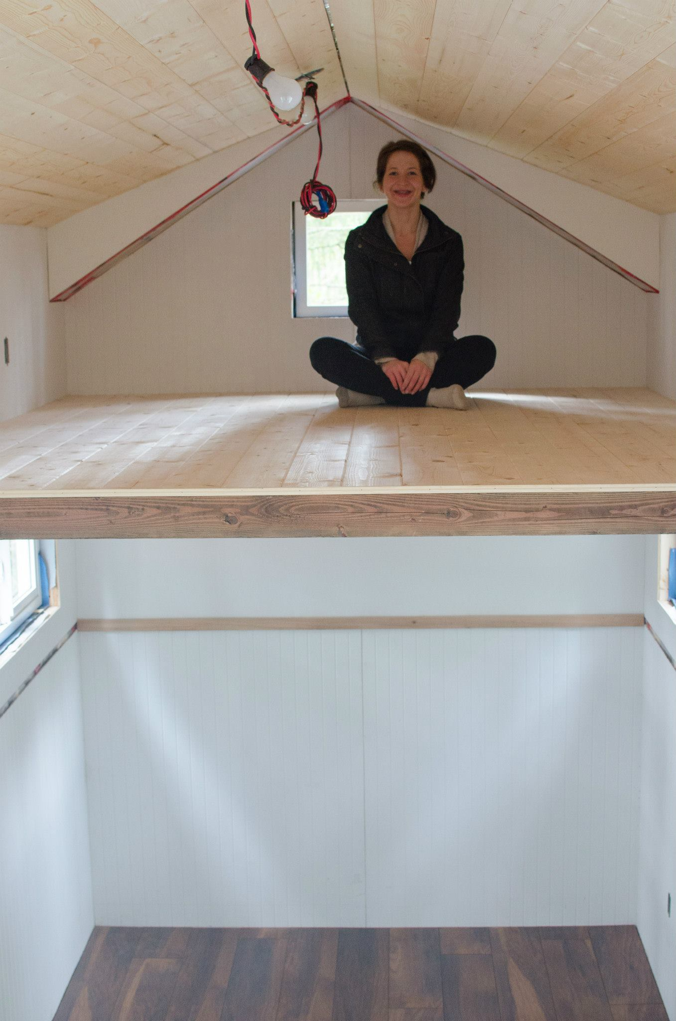There is way more head room than expected in the loft. The floor is a nice light pine.