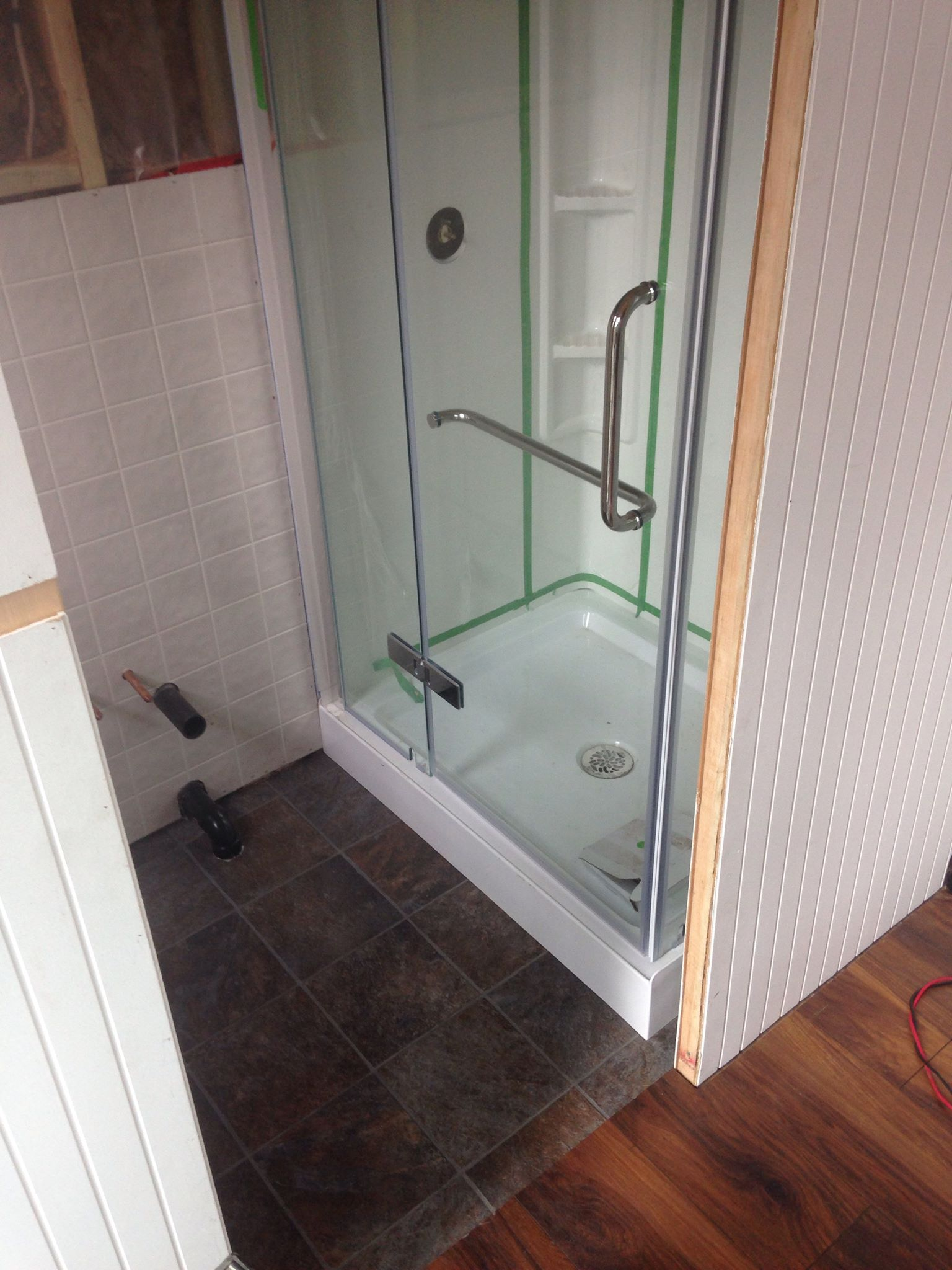 For the ladies: a full size glass shower & laminate tile flooring in the bathroom. The door slides behind the shower, and is opaque to let the light through even when closed (but still give you privacy!).