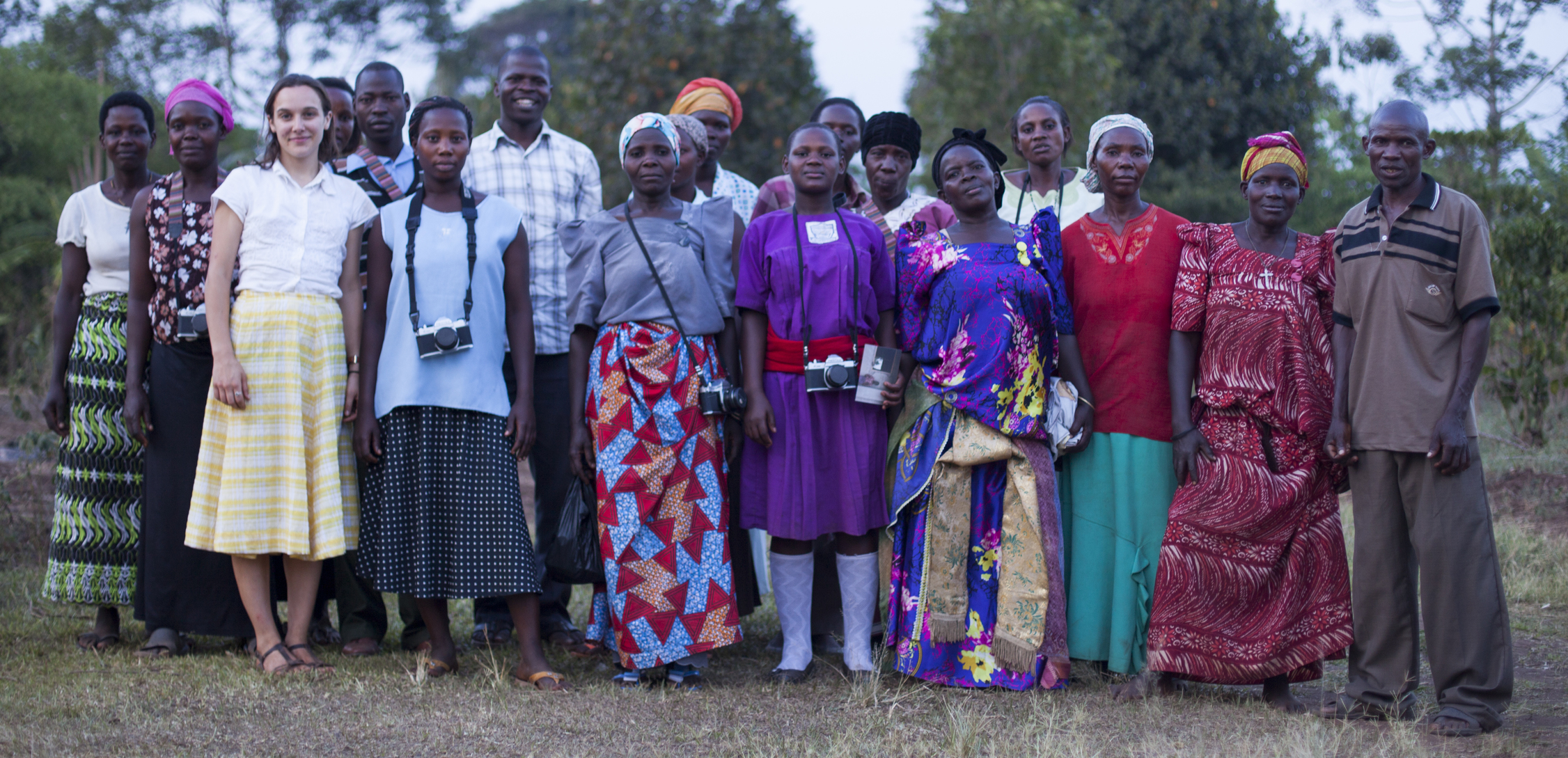 The Wanteete Photo Collective with Project Director Louise Contino and BESO Director Aaron Bukenya.