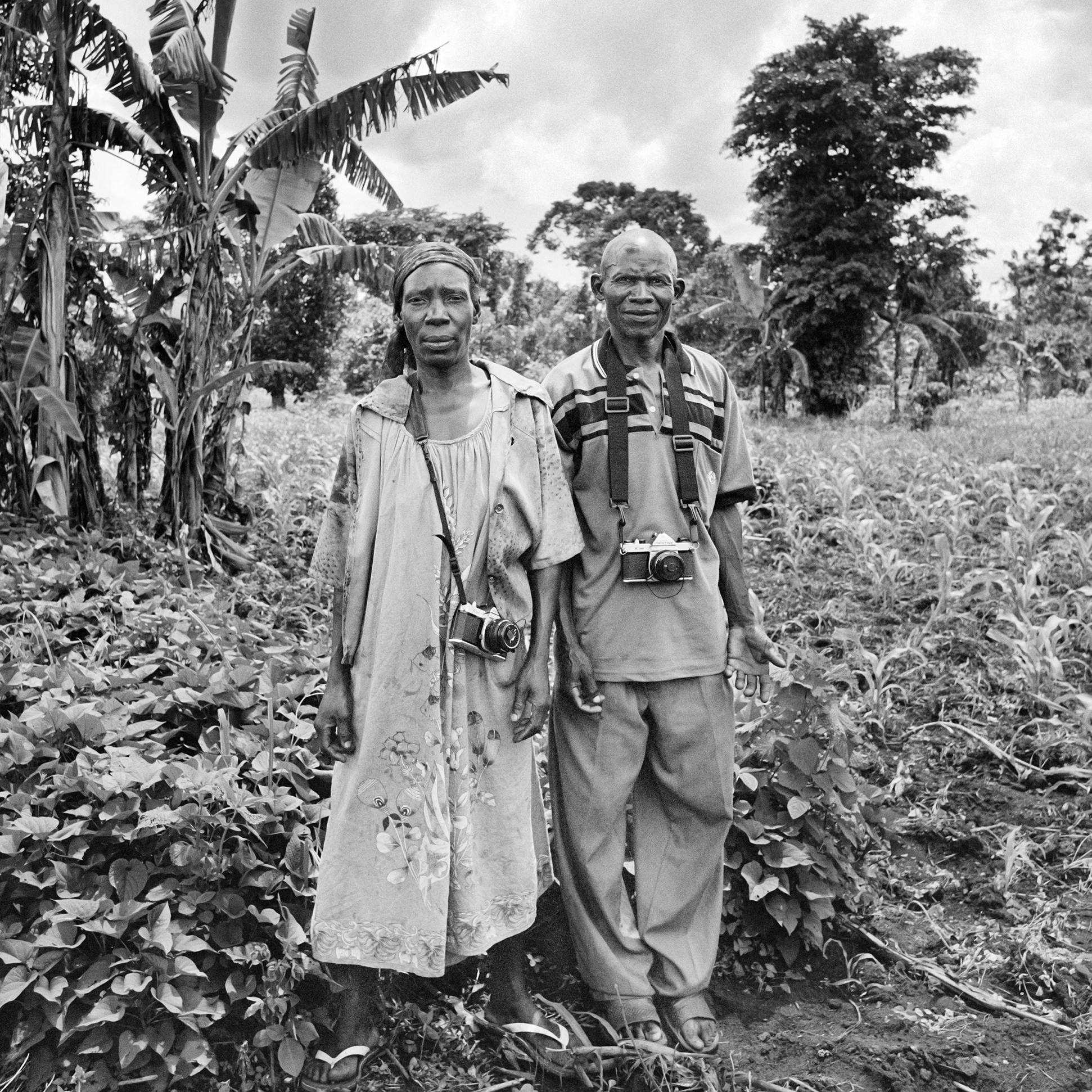 WPC members (from left to right)Athieno Jane and Waiswa John standing in Jane's garden after a long photo-walk.