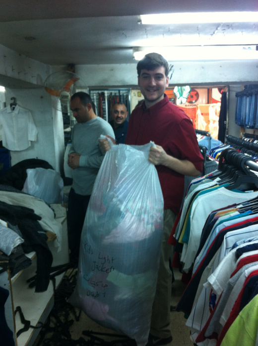 Purchasing used clothing in the markets of Amman.