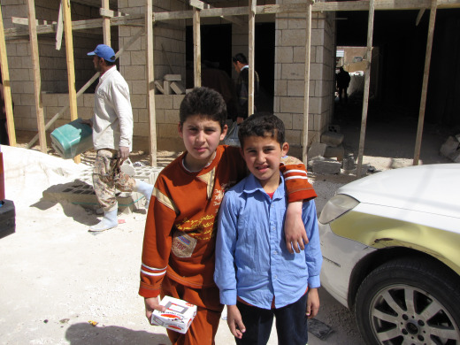 Young boys outside of the soon-to-be community center.