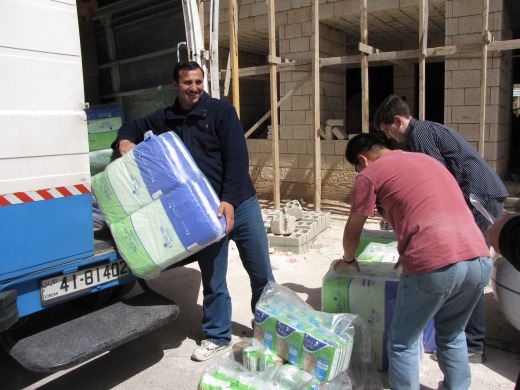 A huge shipment of diapers and sanitary pads funded by us!