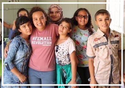 Yasmine with students at The Azraq School