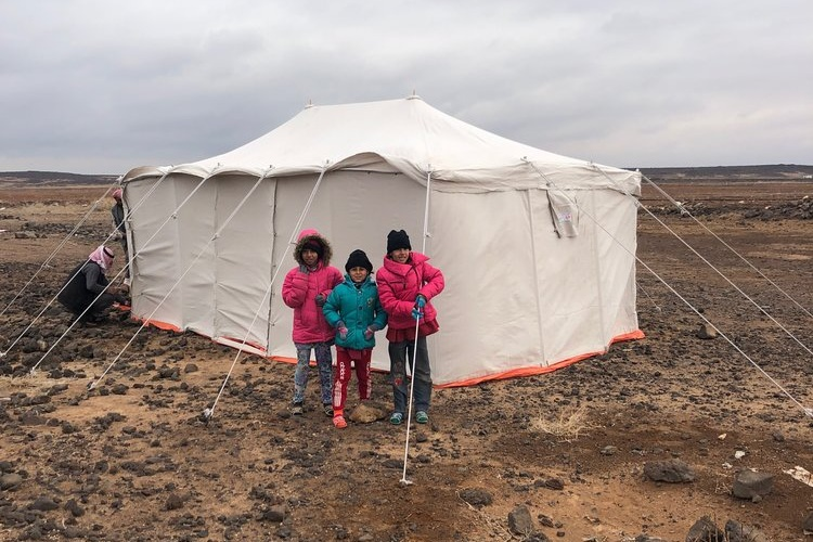 A New Tent- January 2019 - In January, an intense winter storm hit Azraq with freezing temperatures and gale-force winds. A Jordanian family with four young children living in a tent in a rural desert area literally lost their home in the middle of the night when the winds ripped the tent from under them.TSF and our local partners at the South Azraq Women's Association responded immediately. Police picked up the family from the desert and brought them to one of our classrooms that we quickly converted into a shelter for the night.In the morning, we brought warm jackets and other outdoor clothes for the children. We purchased a new sturdy tent and carpet for the family. Within hours, the tent was properly set up and the family was back on their feet.