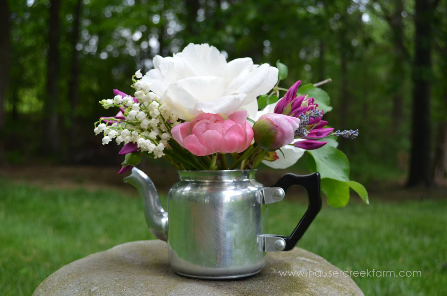 Assorted cut flowers in pinks and white