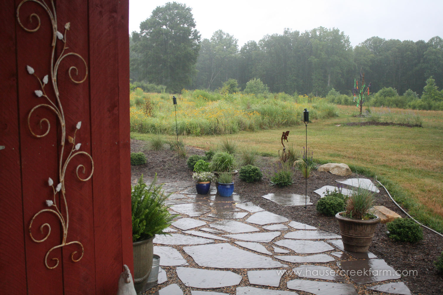 rainy-day-on-the-farm-slate-stepping-stones-planters-red-barn-wall-IMG_9596.jpg