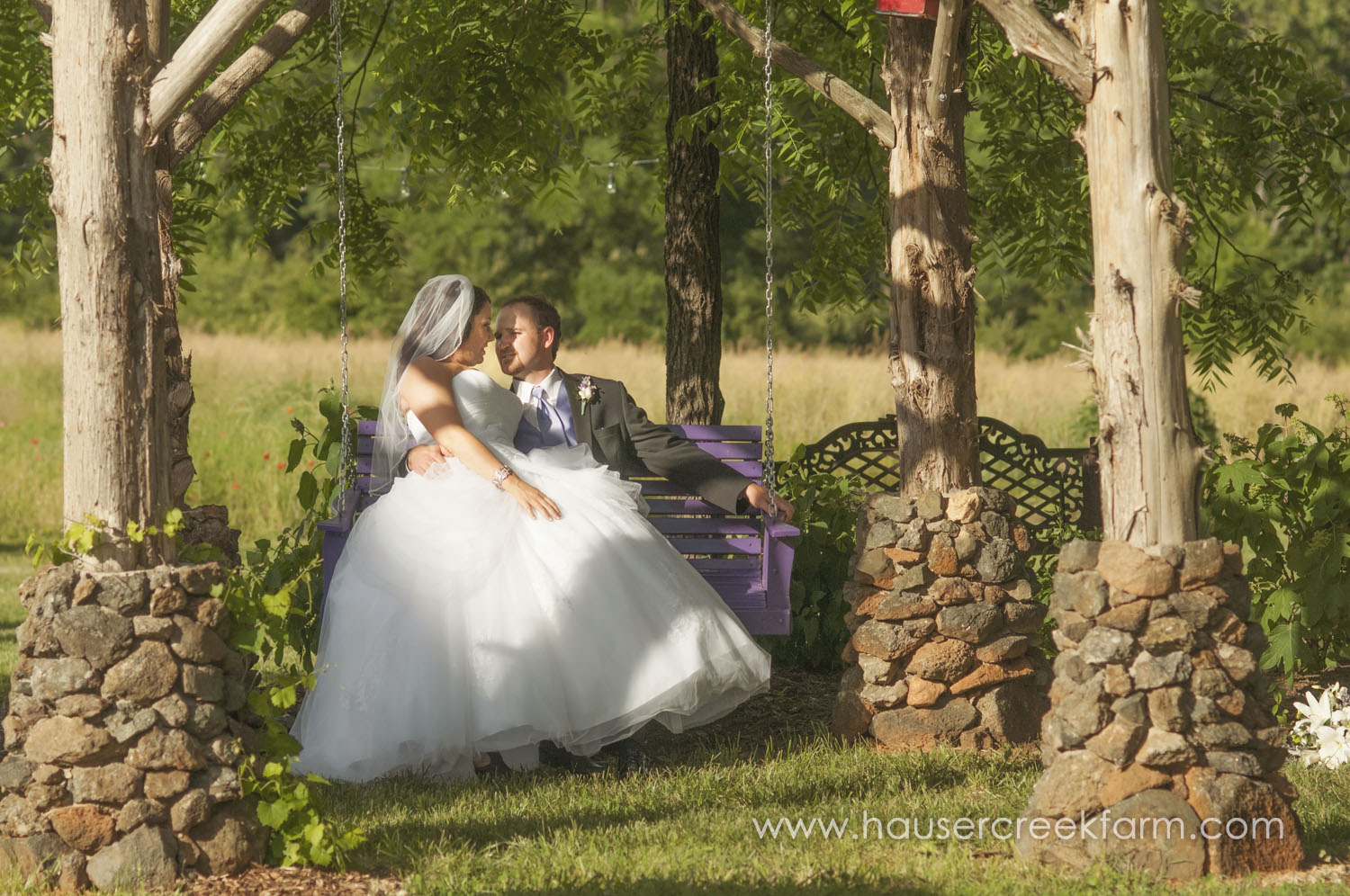 bride-and-groom-purple-swing-under-arbor-a-photo-by-ashley-0870.jpg