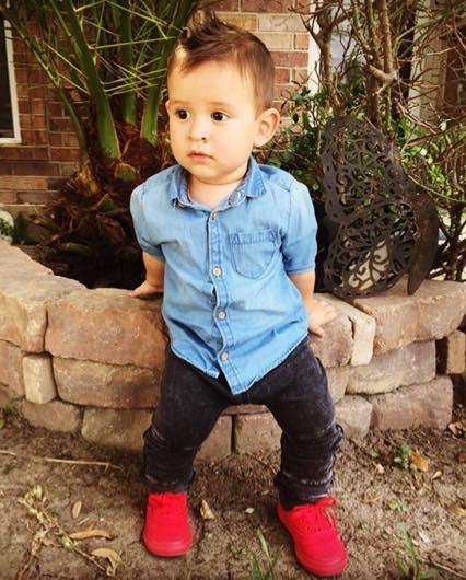 @liam.a.nunez wearing  Zara Kids  denim shirt,  HM  leggings and  Vans  shoes.