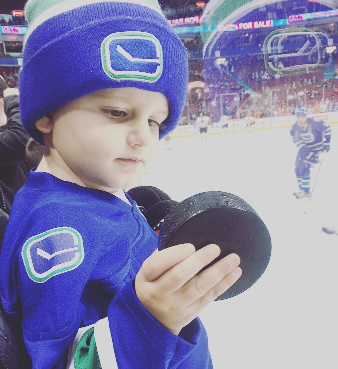 Taking Hudson to his first NHL game and receiving a special puck from an old friend who plays on the Vancouver Canucks.