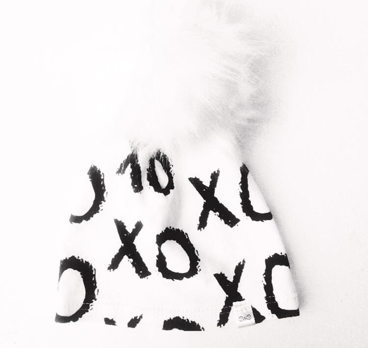 """Buddhibaby  """"X's + O's"""" Pom Beanie (and other items): use code buddhilove for 15% off purchases."""