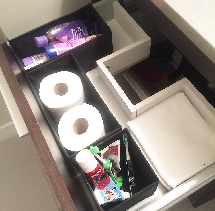 Lotion, baby shampoo, sunscreen, toilet paper, toothpaste + toothbrushes, and towels in the top drawer.