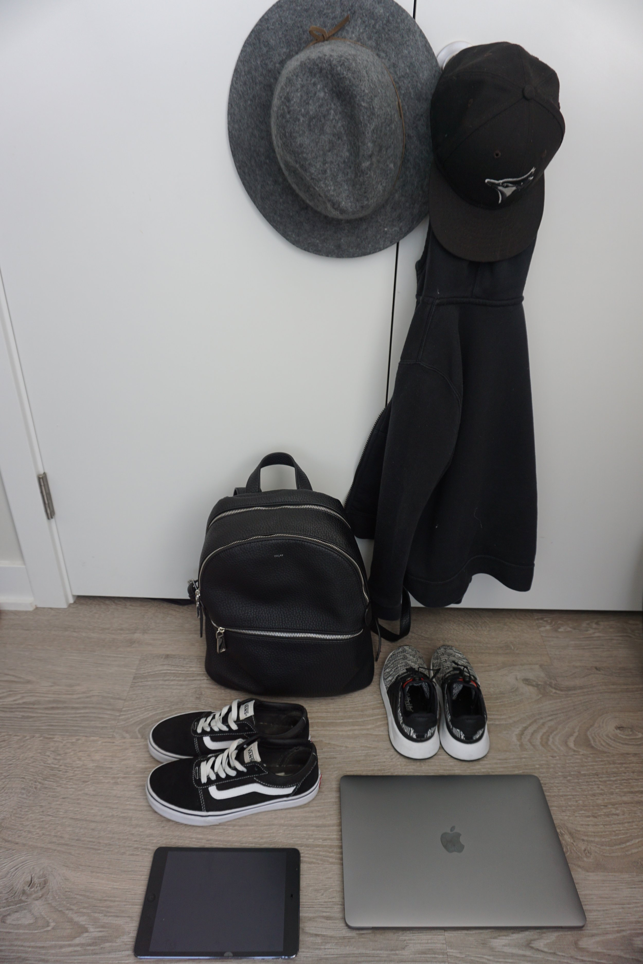 Some of the things we will be wearing/carrying on the plane. A backpack like this counts as a purse, so you could also carry on a bag.