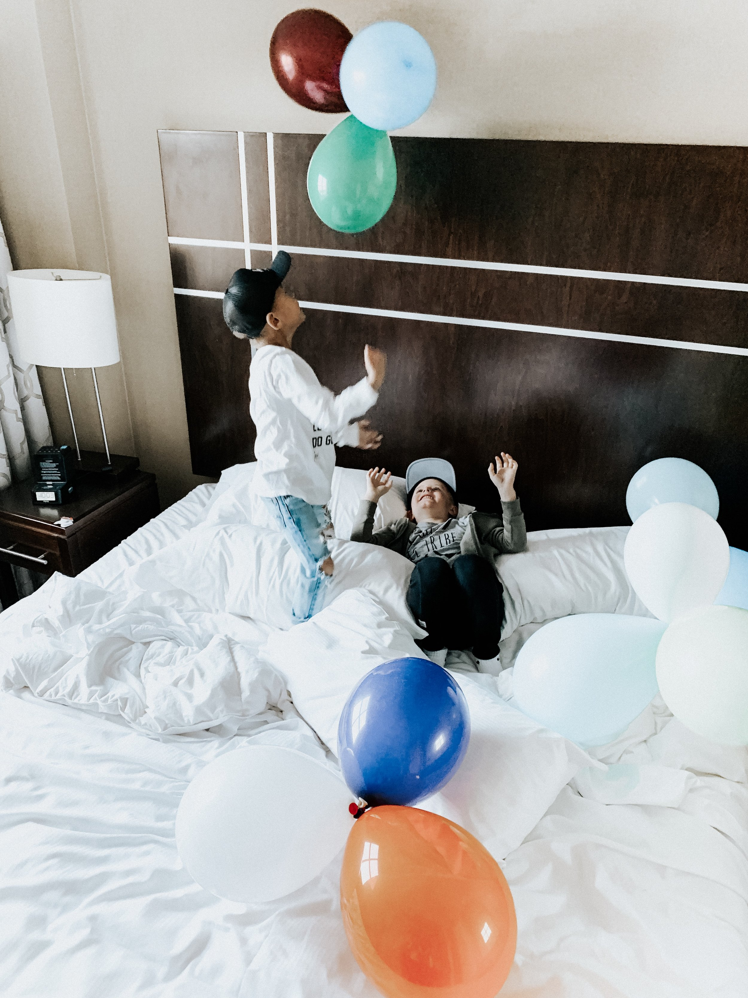 The boys had a hay day jumping on the beds and playing with the balloons!