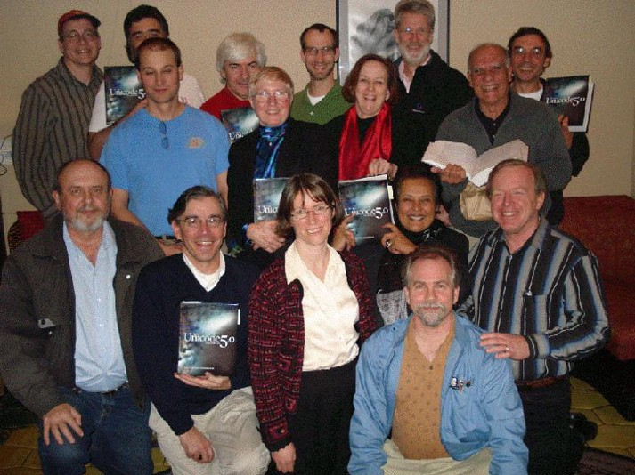 The Unicode Staff and Editorial Committee Members celebrating the publishing of The Unicode Standard Version 5.0 in Mountain View, CA in December 2006. Clearly image resolution was the least of their concerns at the time.