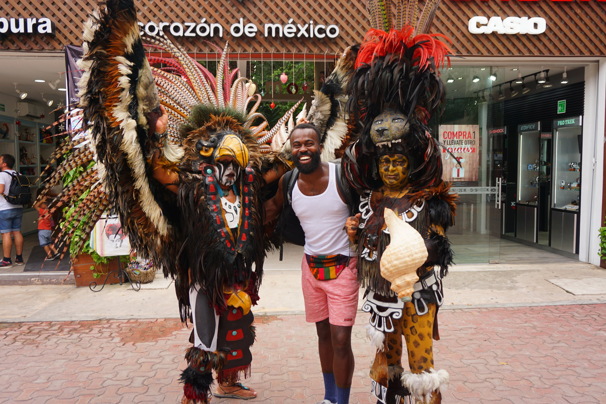 Locals dressed in Mayan ritual attire will take a picture with you on 5th Avenue.