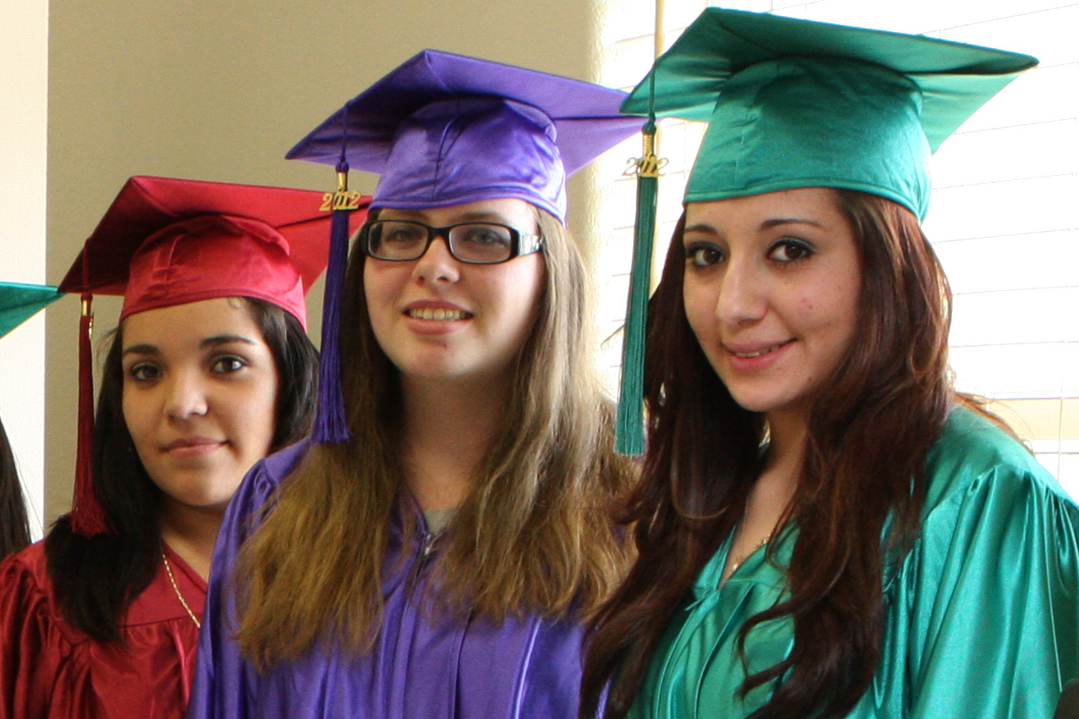 three girls in graduation cap and gown