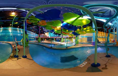 Night time indoor water park with lighting effects showing the lazy river at the Radisson Hotel in Albuquerque, NM