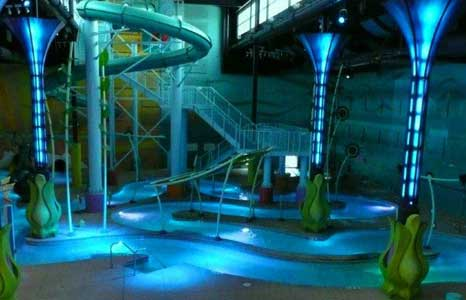 Night time indoor water park with lighting effects at the Radisson Hotel in Albuquerque, NM