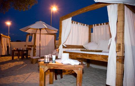 Outdoor cabana seating area at night at Grand Sierra in Reno, NV