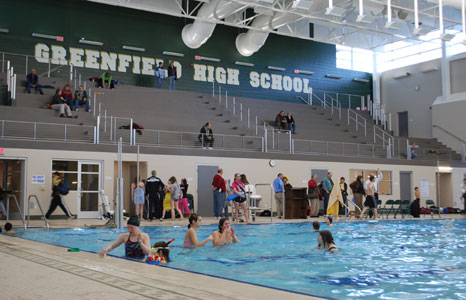 Busy indoor pool area at Greenfield High School in Greenfield, WI