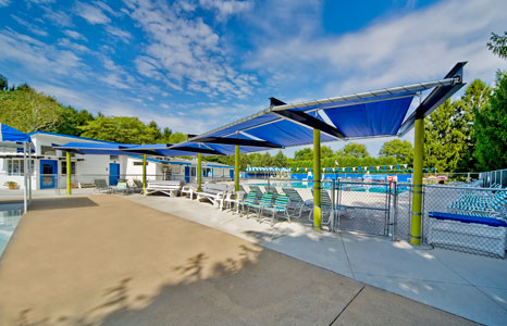 Outdoor pool seating area at the Hill Farm Swim club in Madison, WI