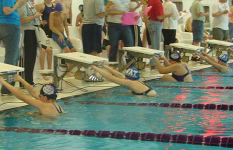 Swim team getting read to start a race in the lap pool at Waunakee High School in Waunakee, WI