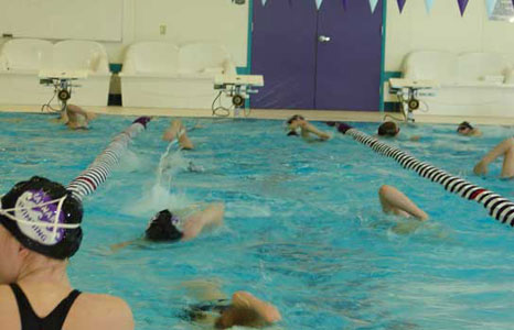 People swimming in the pool at Waunakee High School in Waunakee, WI