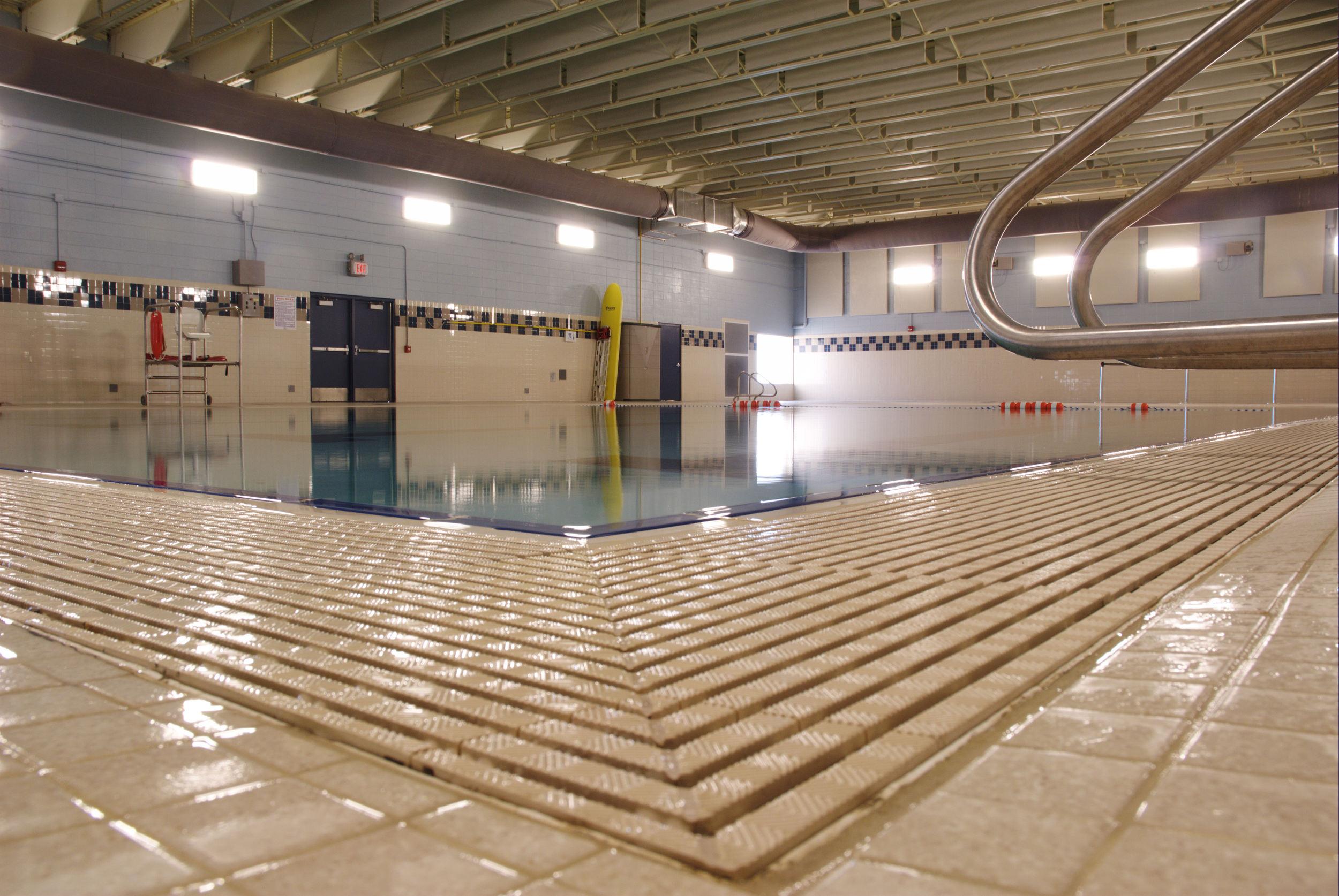 Zoomed in pool deck drains at Poynette High School in Poynette, WI
