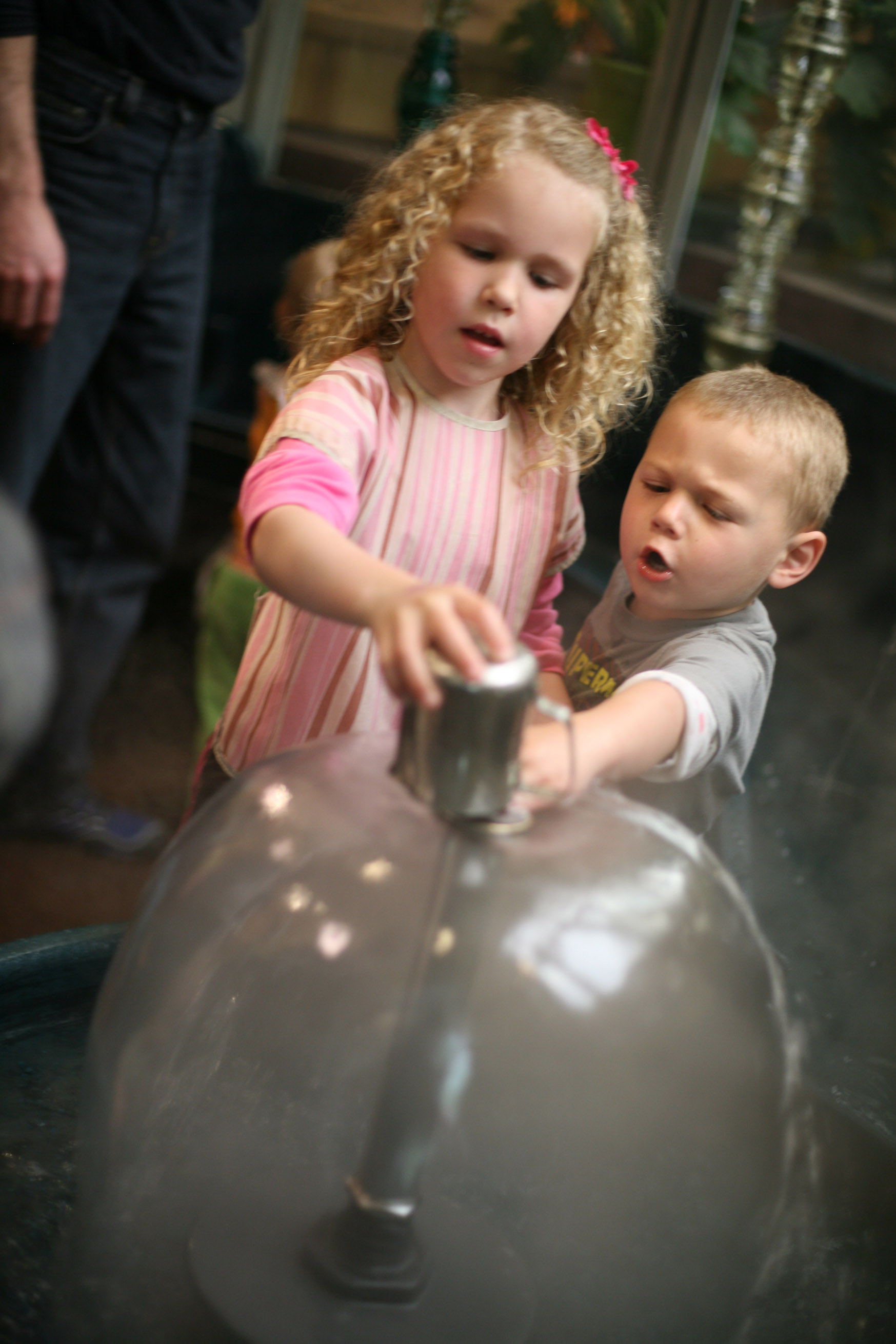 2 kids participating in an exhibit at the Madison Children's Museum in WI