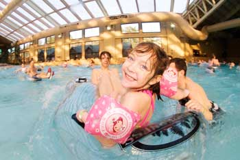Kids playing in a wave pool