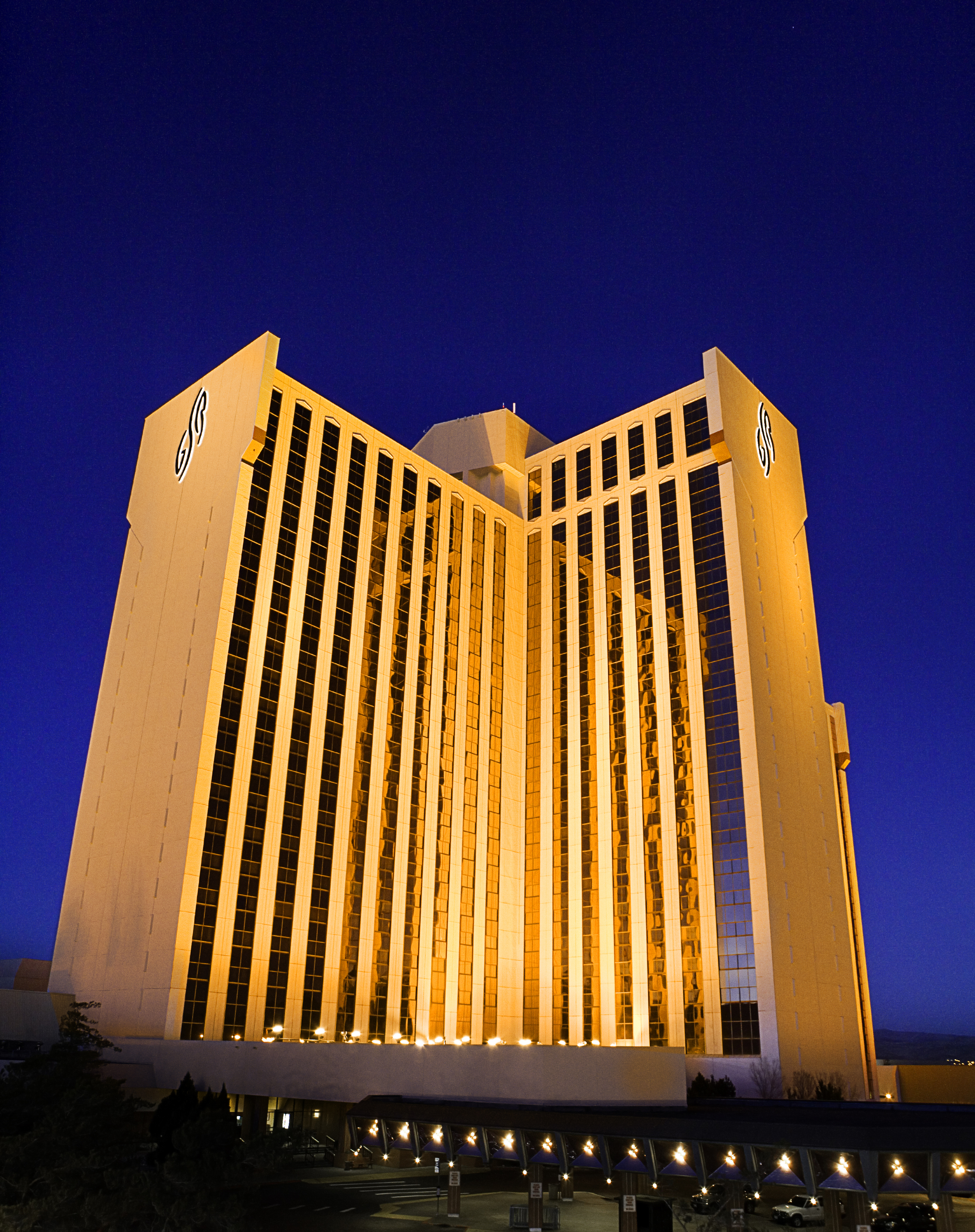 Night time outside view of a 26 Story Hotel/Casino in Reno, NV