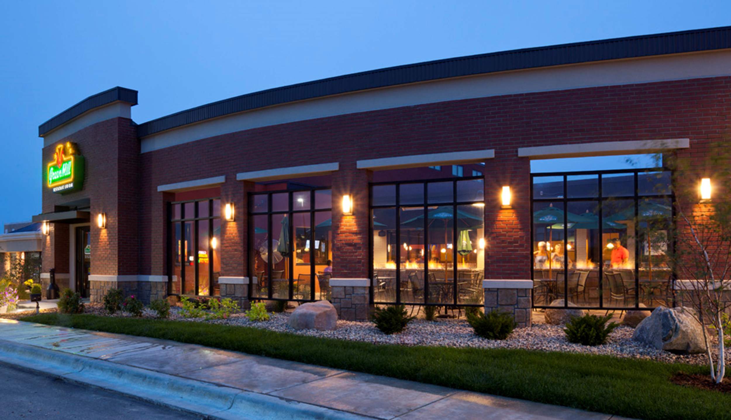 Nighttime outside view of the restaurant attached to Legacy Property in Willmar, MN
