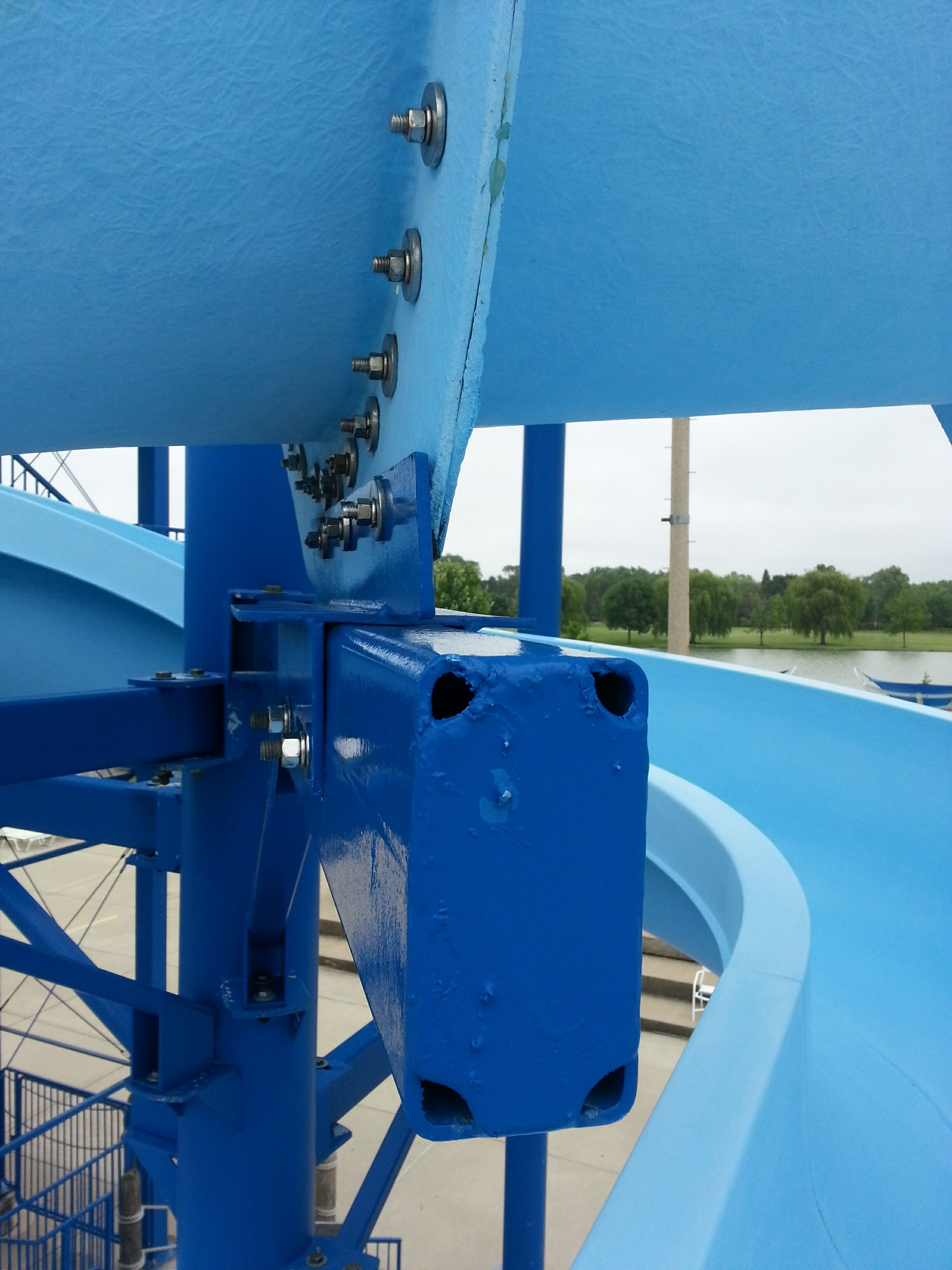 Close up of a blue body water slide