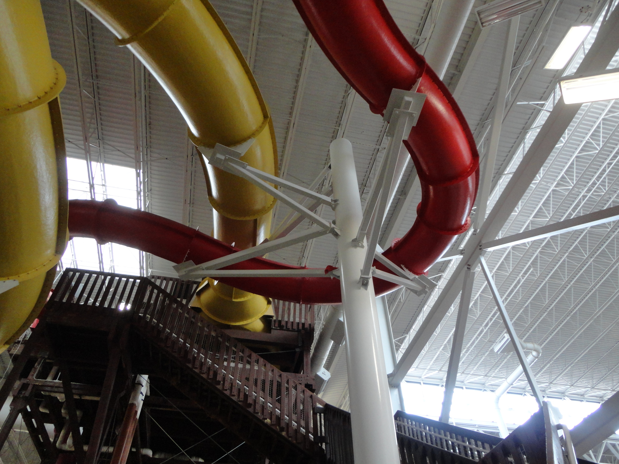 Under side view from the ground of 2 water slides