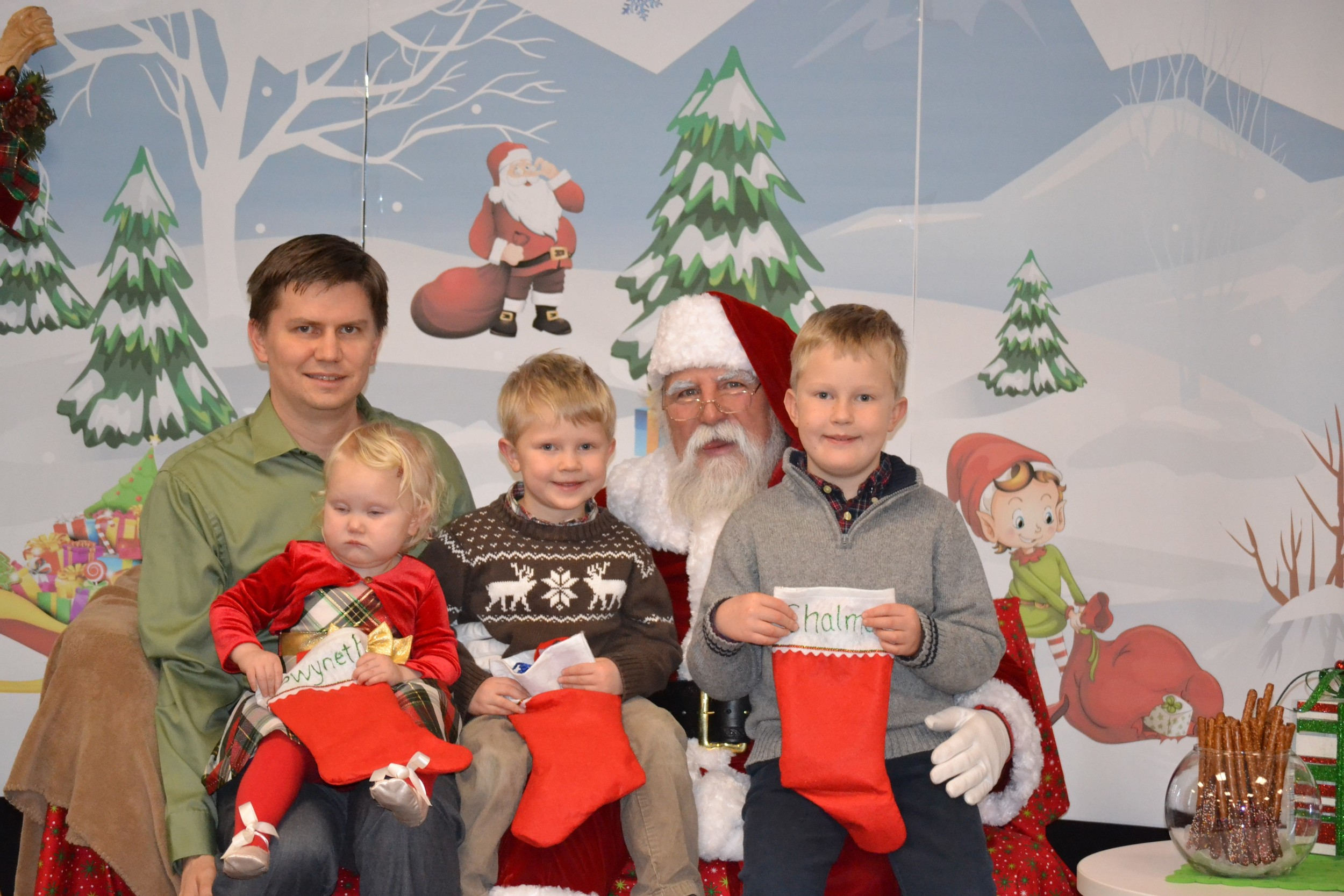 Employee with his 3 kids visiting Santa
