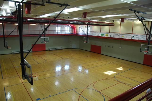 Inside gym and basketball court