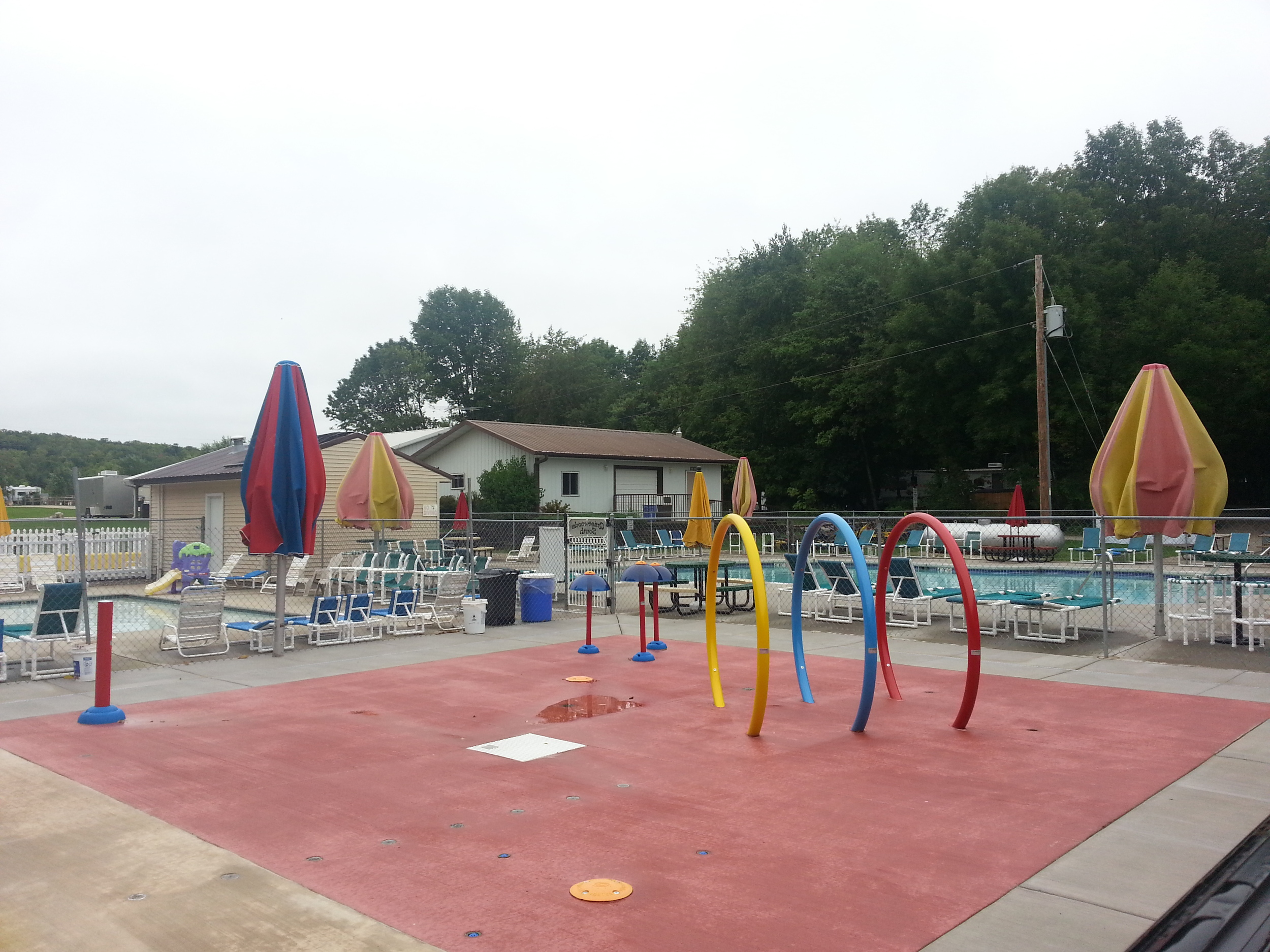 Outdoor plash pad and seating area at Quietwoods South Camping Resort in Brussels, WI