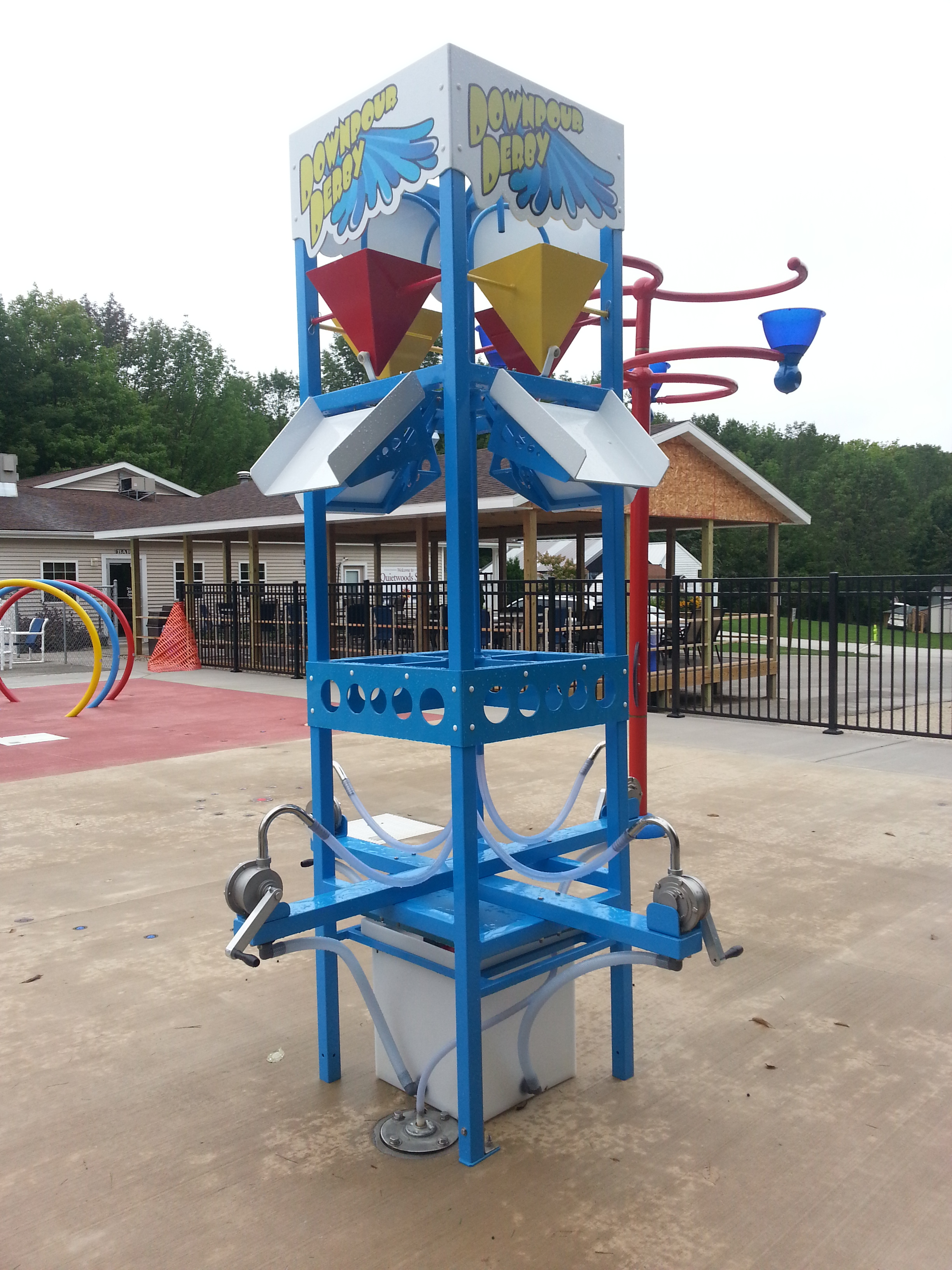 Outdoor plash pad water bucket dropper at Quietwoods South Camping Resort in Brussels, WI