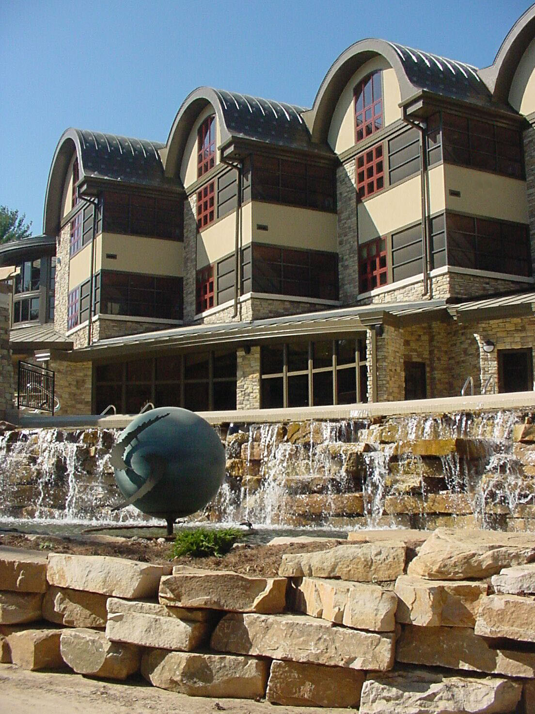 Outside view of the building and fountain area at Sundara Spa in Wisconsin Dells, WI
