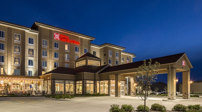 Night time view of the front of Hilton Garden Inn in Bettendorf, IA
