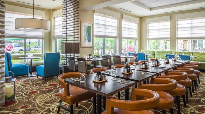 Breakfast seating area at the Hilton Garden Inn in Bettendorf, IA